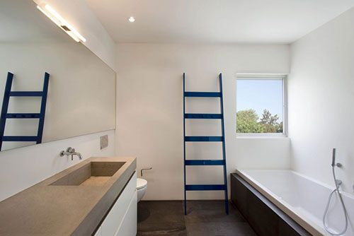 Badkamer met betonnen werkblad wastafel combinatie badkamers