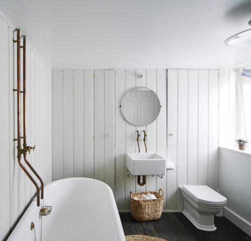 Badkamer met een mix van industrieel en Engels landelijk