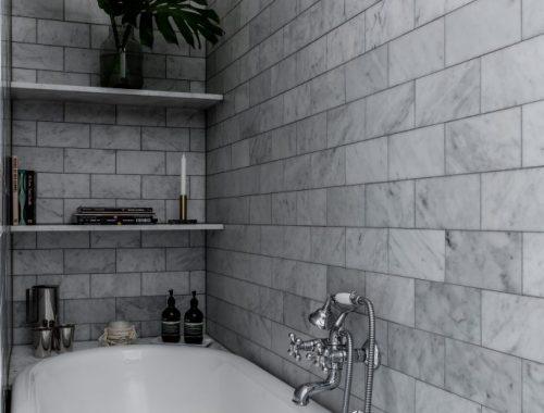 Deze Scandinavische badkamer is ingericht met een klassieke look