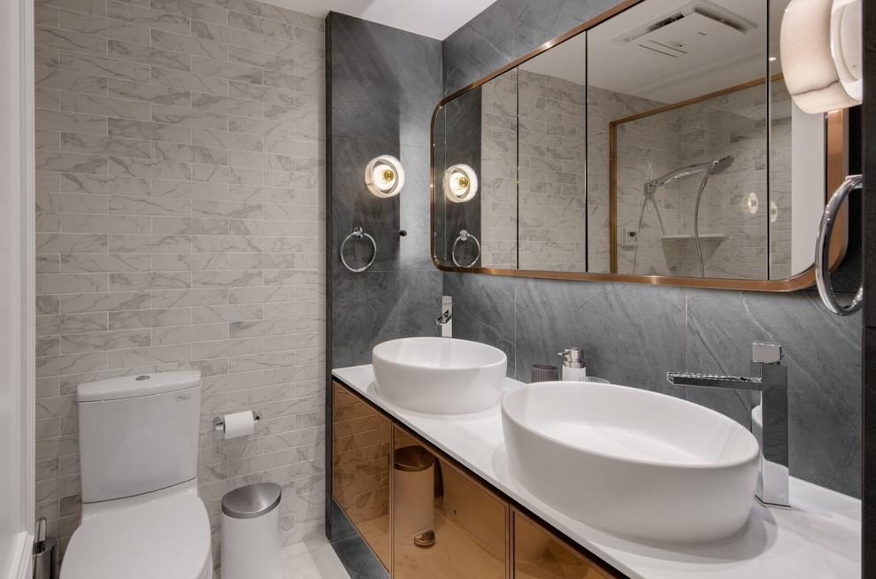 Mooie kleine badkamer met bronzen accenten