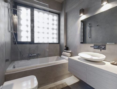 Praktische badkamer met betonstuc