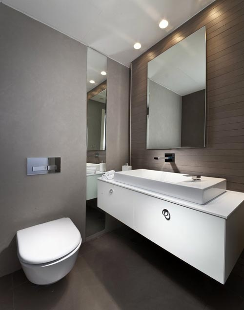 Strakke grijze badkamer in penthouse - Badkamers voorbeelden
