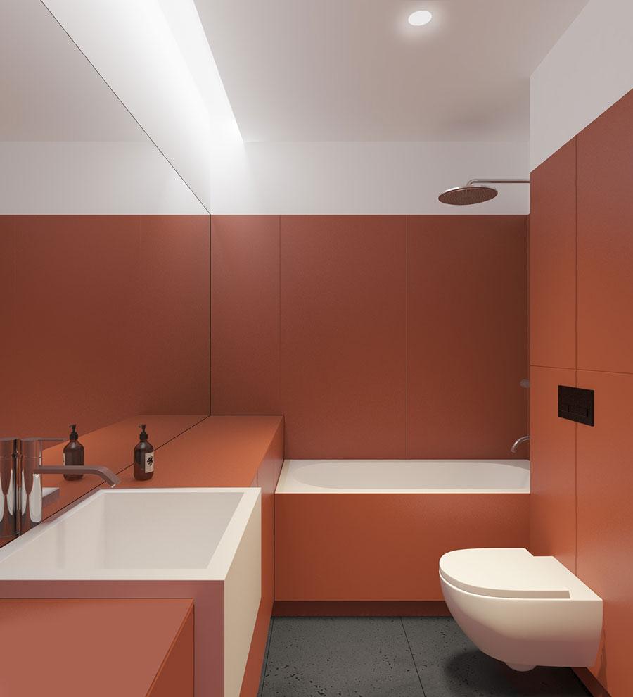 Strakke moderne rode badkamer met een praktische compacte indeling